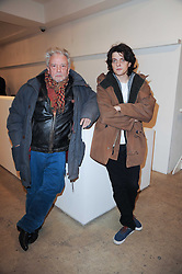 Left to right, DAVID BAILEY and his son FENTON BAILEY at a private view of Masters of Photography - A Journey presented by Macallan and Albert Watson held at Philips De Pury, Howick Place, London SW1 on 1st December 2010.