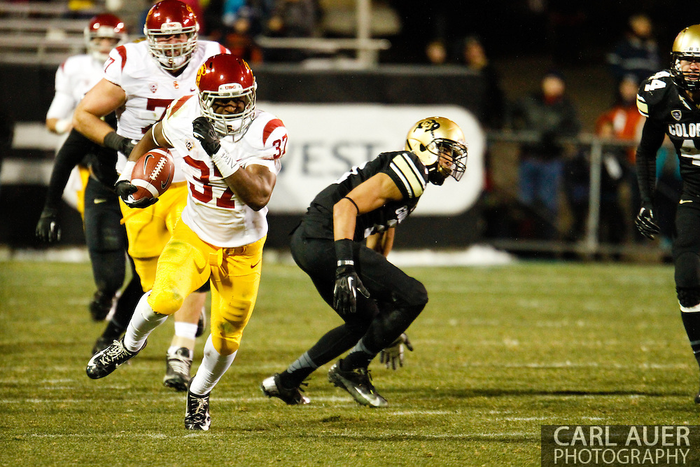 November 23rd, 2013: USC Trojans sophomore running back Javorius Allen (37) runs the ball towards the sideline in the third quarter of the NCAA Football game between the University of Southern California Trojans and the University of Colorado Buffaloes at Folsom Field in Boulder, Colorado