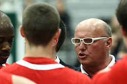 10 January 2015:  Mike Leazer gets a few words of encouragement from Bosko Djurickovic in a time out huddle during an NCAA mens division 3 CCIW basketball game between the Carthage Reds and the Illinois Wesleyan Titans in Shirk Center, Bloomington IL