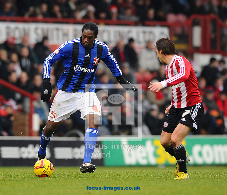 Picture by Seb Daly/Focus Images Ltd +447738 614630<br /> 26/12/2013<br /> Nile Ranger of Swindon Town takes on Sam Saunders of Brentford during the Sky Bet League 1 match at Griffin Park, London.