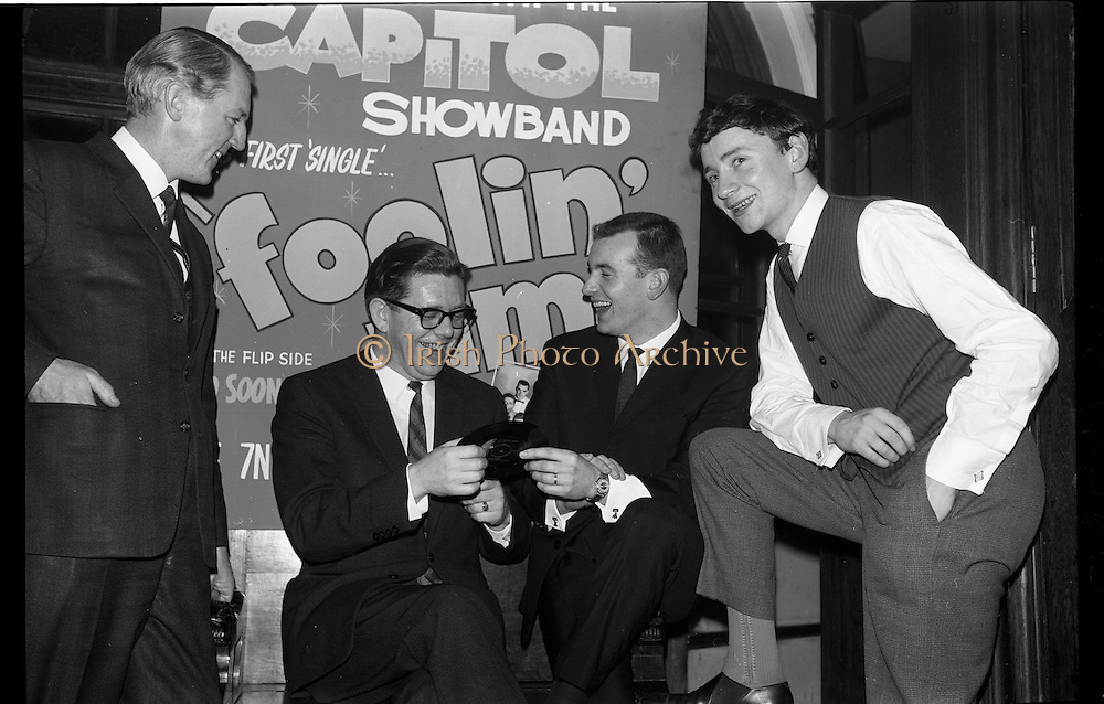 03/02/1964<br /> 02/03/1964<br /> 03 February 1964 <br /> Capitol Show Band and Pye Records reception for single 'Foolin' Time' at Country Club Portmarnock. Image shows Telefis Eireann personnel with Butch Moore and Phil Coulter.