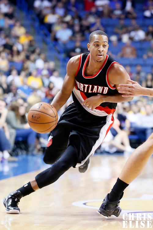 22 October 2014: Portland Trail Blazers guard C.J. McCollum (3) drives past Los Angeles Lakers guard Jeremy Lin (17) during the Los Angeles Lakers 94-86 victory over the Portland Trail Blazers, in a preseason game, at the Citizens Business Bank Arena, Ontario, California, USA.