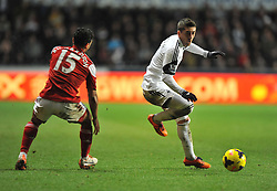 Swansea City's Pablo Hernandez makes his way past Fulham's Kieran Richardson - Photo mandatory by-line: Alex James/JMP - Tel: Mobile: 07966 386802 28/01/2014 - SPORT - FOOTBALL - Liberty Stadium - Swansea - Swansea City v Fulham - Barclays Premier League