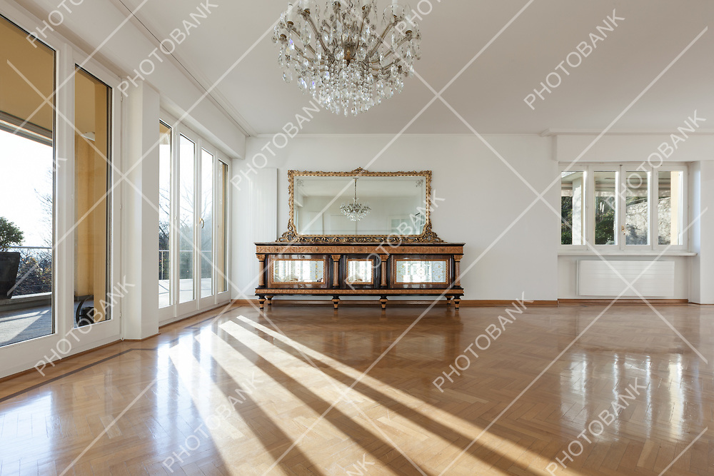 interior of an house, empty room with a period cabinet, parquet floor and white walls