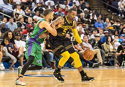 July 6, 2018 - Oakland, CA, U.S. - OAKLAND, CA - JULY 06: Stephen Jackson (5) co-captain of the Killer 3s pushes past Mahmoud Abdul-Rauf (7) co-captain of 3 Headed Monsters during game 4 in week three of the BIG3 3-on-3 basketball league on Friday, July 6, 2018 at the Oracle Arena in Oakland, CA (Photo by Douglas Stringer/Icon Sportswire) (Credit Image: © Douglas Stringer/Icon SMI via ZUMA Press)