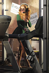 Singer Paloma Faith wearing a green dress and high heels, running on a treadmill for Radio Around the World - Sport Relief Challenge at the BBC studios in London, UK. 19/03/2014<br />BYLINE MUST READ : GOTCHAIMAGES.COM<br /><br />Copyright by © Gotcha Images Ltd. All rights reserved.<br />Usage of this image is conditional upon the acceptance <br />of Gotcha Images Ltd, terms and conditions available at<br />www.gotchaimages.com