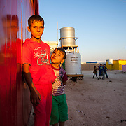 Ibrahim, 9 and Amir, 7. Zaatari Camp for Syrian Refugees, Jordan, July 2015.