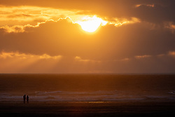 © Licensed to London News Pictures. 01/07/2020. Perranporth, UK. The sun sets on Perranporth beach, Cornwall. From this weekend, a large number of tourists are expected to arrive in Cornwall, as the regulations on COVID-19 (Coronavirus) are lifted. Photo credit : Tom Nicholson/LNP