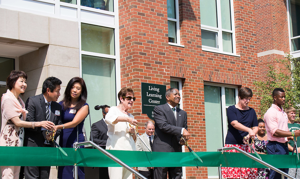 President McDavis and the families and honories cut the ribbion marking the grand opening of the new residential halls on south green.