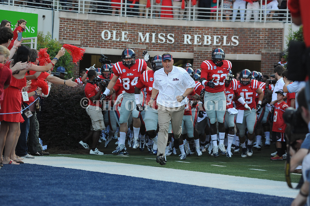 Ole Miss Coach Hugh Freeze leads the team onto the field before the game vs. UTEP at Vaught-Hemingway Stadium in Oxford, Miss. on Saturday, September 8, 2012. Ole Miss won 28-10.