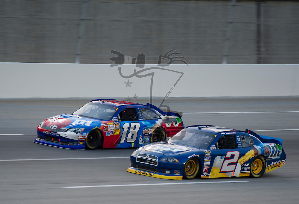 Sparta, KY - JUN 30, 2012: Brad Keselowski (2) and Kyle Busch (18) during the Quaker State 400 at  Kentucky Speedway in Sparta, KY.