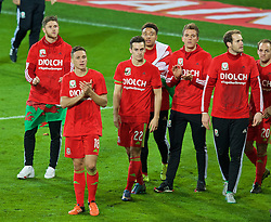 CARDIFF, WALES - Tuesday, October 13, 2015: Wales players celebrate after qualifying for the finals following a 2-0 victory over Andorra during the UEFA Euro 2016 qualifying Group B match at the Cardiff City Stadium. Wes Burns, James Chester, Tom Lawrence, Adam Henley, Emyr Huws, goalkeeper Owain Fon Williams. (Pic by Paul Currie/Propaganda)