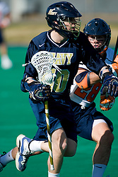 Navy attackman Gregory Clement (10) is defended by Virginia defenseman Tim Shaw (28).  The Virginia Cavaliers scrimmaged the Navy Midshipmen in lacrosse at the University Hall Turf Field  in Charlottesville, VA on February 2, 2008.