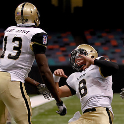 October 9, 2010; New Orleans, LA, USA;  Army Black Knights wide receiver Davyd Brooks (13) celebrates with quarterback Trent Steelman (8) following a touchdown against the Tulane Green Wave during the first half at the Louisiana Superdome.  Mandatory Credit: Derick E. Hingle