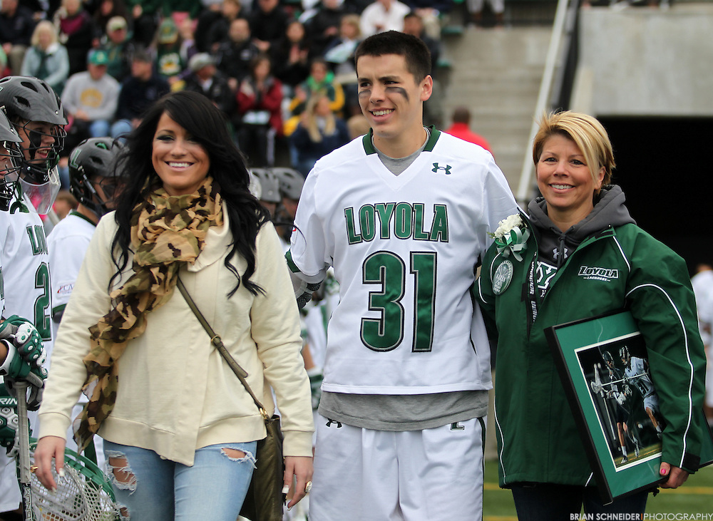 April 28, 2012; Baltimore, MD, USA; Loyola Greyhounds defender Dylan Grimm (31) walks in with family before the game against the Johns Hopkins Blue Jays at  Ridley Athletic Complex in Baltimore, MD. Mandatory Credit: Brian Schneider-www.ebrianschneider.com
