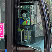 LYNX bus drivers in downtown Orlando wear safety gear as they run their routes on Monday, March 30, 2020 in Orlando, Florida. (Alex Menendez via AP)