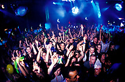 Ravers raise their arms at Gods Kitchen / Global Gathering U.K 2000