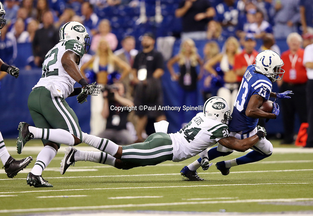 New York Jets cornerback Darrelle Revis (24) dives and Indianapolis Colts wide receiver T.Y. Hilton (13) on a third quarter pass reception during the 2015 NFL week 2 regular season football game against the Indianapolis Colts on Monday, Sept. 21, 2015 in Indianapolis. The Jets won the game 20-7. (©Paul Anthony Spinelli)