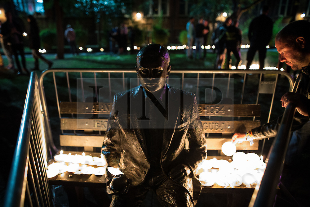 © Licensed to London News Pictures . 31/08/2015 . Manchester , UK . People leave lit candles beside a statue of Alan Turing at a candlelit vigil in memory of the victims of HIV and AIDS , in Sackville Gardens in Manchester's Gay Village , closes 2015 Manchester Pride . Photo credit : Joel Goodman/LNP