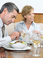 Businesspeople Eating at Restaurant