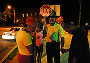 As police patrol the neighborhood known for drugs and violence, Pastor L.B. Towns, middle, stops to pray with a group of people outside the K&B Market at 4th Street and 8th Avenue in the Short North area on July 16.