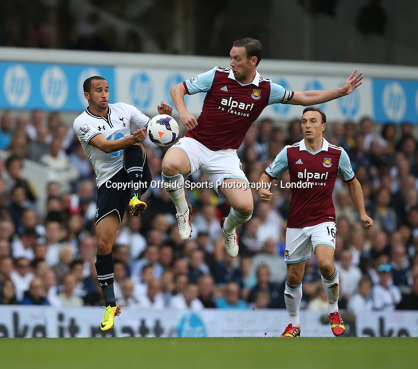 06 October 2013 Premier League Football - Tottenham Hotspur v West Ham United -<br /> <br /> Andros Townsend is beaten to the ball by West Ham captain Kevin Nolan.<br /> <br /> Photo: Mark Leech