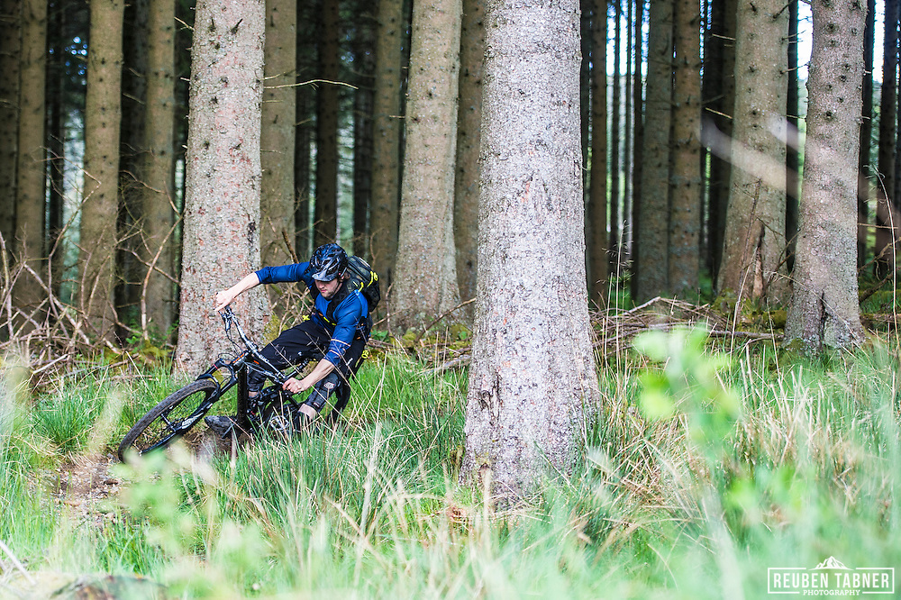Ed Thomsett nips through the trees at Kielder Forest on his Vitus Sommet CR.