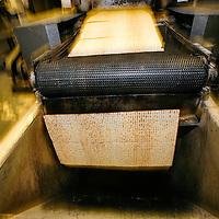 Burnt or irregular matzoh is sent down a chute to be ground into matzoh meal. Streit's Matzoh, NYC.