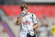 Jimmy Adams of Hampshire  walks back to the pavilion with a hand over his face after being dismissed by Steven Patterson of Yorkshire during the Specsavers County Champ Div 1 match between Hampshire County Cricket Club and Yorkshire County Cricket Club at the Ageas Bowl, Southampton, United Kingdom on 1 September 2016. Photo by Graham Hunt.