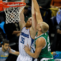 December 28, 2011; New Orleans, LA, USA; Boston Celtics center Greg Stiemsma (54) blocks a dunk attempt by New Orleans Hornets center Chris Kaman (35)  during the second quarter of a game at the New Orleans Arena.   Mandatory Credit: Derick E. Hingle-US PRESSWIRE