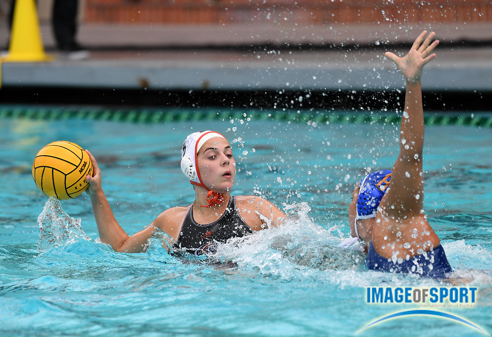 Pacific Tigers attacker Mariana Duarte (5) is defended by UCLA Bruins attacker Devin Grab (8) during an NCAA college women's water polo quarterfinal game in Los Angeles, Friday, May 11, 2018. UCLA defeated Pacific, 8-4.