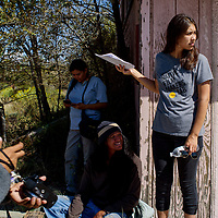 """Writer director Shaandiin Tome, right, holds up a script to help shade one of her actors on the set of her film """"Mud"""" in Gallup Monday."""