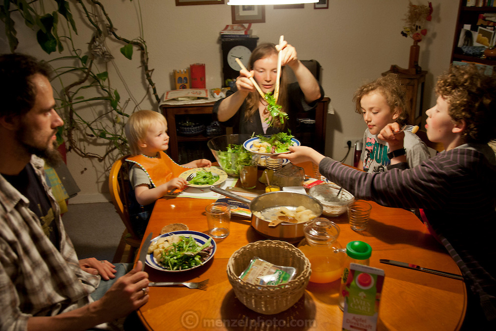 Hollmann Sturm family in Hamburg, Germany photographed for the Hungry Planet: What I Eat project with a week's worth of food. Astrid Hollmann, 38, and Michael Strum, 38, and their three children Lenard, 12, Malte Erik, 10, and Lillith, 2.5 Model Released.