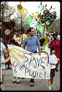 Kids and adults march in Earth Day parade with Save the Planet banner; Forest Park, St. Louis. Missouri