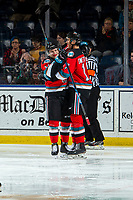 KELOWNA, BC - NOVEMBER 8: Pavel Novak #11 and Alex Swetlikoff #17 of the Kelowna Rockets celebrate a second period goal against the Medicine Hat Tigers  at Prospera Place on November 8, 2019 in Kelowna, Canada. (Photo by Marissa Baecker/Shoot the Breeze)