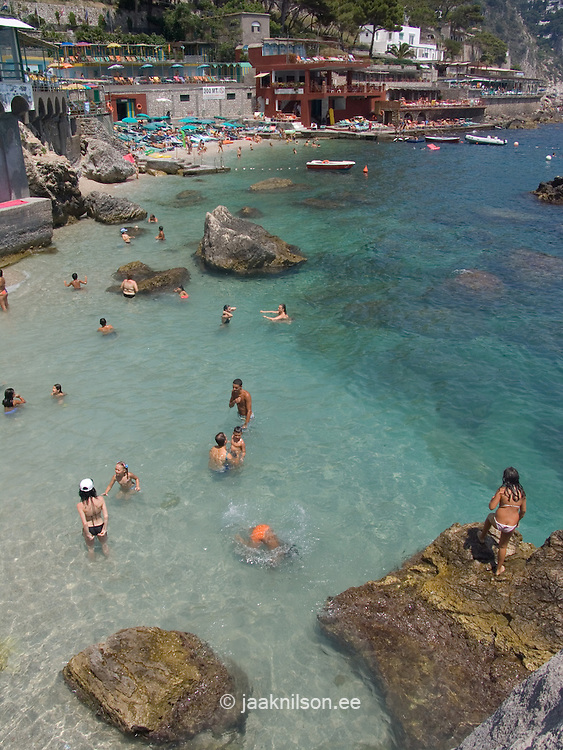 Sunbathers on beach at Marina Piccola, Capri Island, Italy