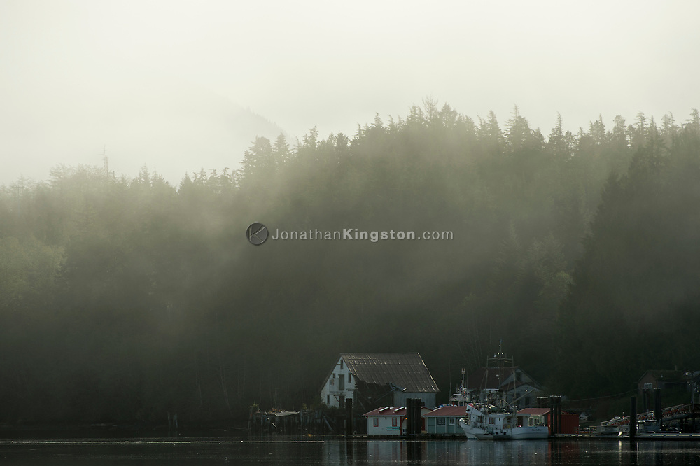 Fog lifts from a small fishing village on the Inside Passage, BC.