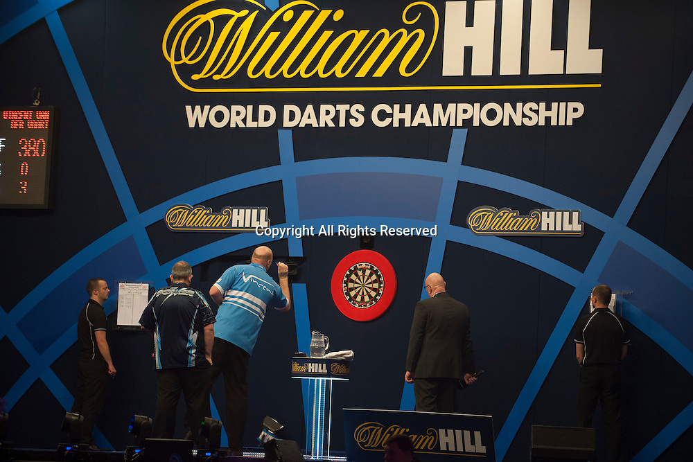 02.01.2014.  London, England.  William Hill PDC World Darts Championship.  Quarter Final Round.  Vincent van der Voort (23) [NED] in action during his game with Phil Taylor (2) [ENG]. Phil Taylor won the match 5-3