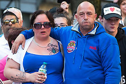 © Licensed to London News Pictures . 25/05/2017 . Manchester , UK . Mother and father of of bombing victim Olivia Campbell , CHARLOTTE CAMPBELL (with new Manchester Bee tattoo and tribute to Olivia) and PAUL HODGSON attend a scooter-led rally to lay flowers at St Ann's Square in Central Manchester , following a terrorist attack at an Ariana Grande concert at Manchester Arena that killed twenty two people . Photo credit : Joel Goodman/LNP
