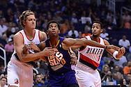 Nov 2, 2016; Phoenix, AZ, USA; Phoenix Suns forward Marquese Chriss (0) boxes out Portland Trail Blazers forward Meyers Leonard (11) and guard Evan Turner (1) during the first half at Talking Stick Resort Arena. Mandatory Credit: Jennifer Stewart-USA TODAY Sports