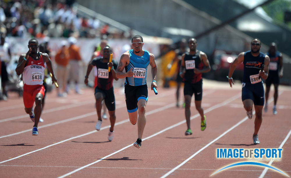 Mar 31, 2012; Austin, TX, USA; Wallace Spearmon (center) runs the anchor leg on the Speed United 4 x 100m relay that won in 38.64 in the 85th Clyde Littlefield Texas Relays at Mike A. Myers Stadium.
