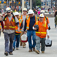 Construction workers walk along the Santa Monica Boardwalk on Saturday, February 2, 2013.