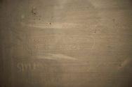Roma 28 Maggio 2010.Museo Storico della Liberazione .Via Tasso 155,  era il Comando SS e Gestapo, della polizia Nazista  durante l'occupazione da parte delle  Germania durante la Seconda Guerra Mondiale..Le celle dove venivano tenuti i combattenti della resistenza romana.Le scritte sui muri di una cella fatte dai prigionieri..Rome, May 28, 2010.Historical Museum of the Liberation.Via Tasso 155, was the SS and Gestapo Command, the police during the Nazi occupation by Germany during the Second World War. The graffiti made by prisoners in a cell.The cells were kept where resistance fighters Roman