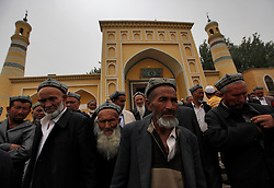 A picture made available on 31 May 2013 of Muslim men of the Uighur  ethnic group leaving the Id Kah Mosque after Friday prayers in Kashgar, western edge of China's Xinjiang Uighur Autonomous Region, China 24 May 2013. Uighurs, a Muslim ethnic minority group in China, make up about 40 per cent of the 21.8 million people in Xinjiang, a vast ethnically divided region that borders Pakistan, Afghanistan, Kazakhstan, Kyrgyzstan and Mongolia. Other ethnic minorities living in here include the Han Chinese, Kyrgyz, Mongolian and Tajiks people. In the restive region of Kashgar, western end of Xinjiang where the North and South Silk road meets, Uighurs comprise of more than 90 per cent of the 3.9 million population. Most practice a moderate form of Islam and religion is a major part of most ordinary Uighurs' lives. Tensions have been high between the Uighurs and the dominant Han Chinese as Uighurs complain of cultural and religious repression and claim that Han Chinese migrants enjoy the main benefits of development in the oil-rich but economically backward region.