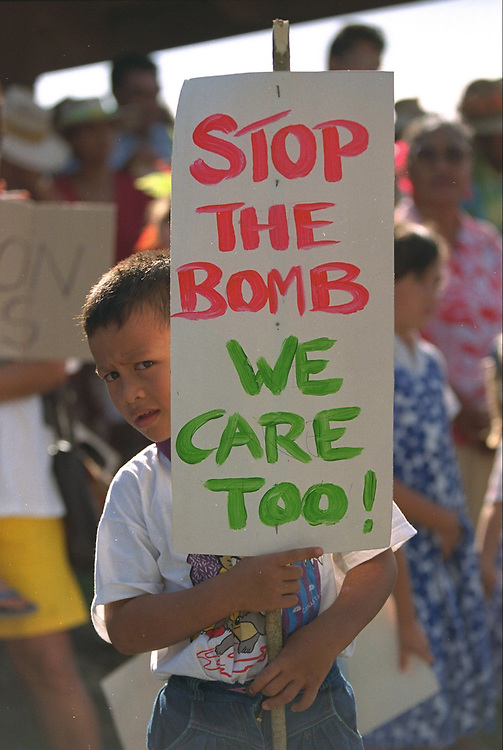 More than 1500 people, nearly one quarter of Rarotonga's 8000 population, marched against French nuclear testing from the RAINBOW WARRIOR II to the town centre.  The RAINBOW WARRIOR II was visiting the Cook Islands en route to the French nuclear test site of Moruroa to protest against French President Chirac's decision to resume nuclear testing. Rarotonga, Cook Islands, Pacific. Accession #: 2.95.205.007.12