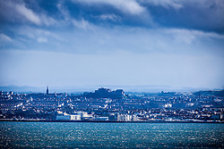 Edinburgh Castle and skyline, and the River Forth coastline, as seen from the A921 near Burntisland, Fife.