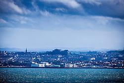 Edinburgh Castle and skyline, and the River Forth coastline, as seen from the A921 near Burntisland, Fife.