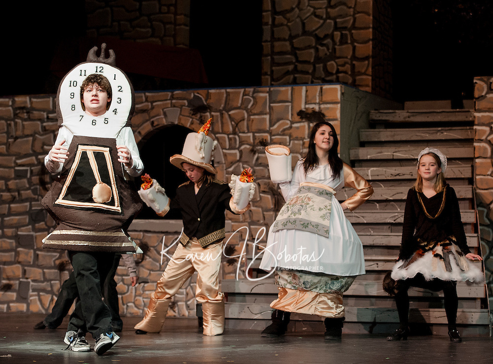 """Cogsworth (Ryan Witham),  Lumeire (Taryn Fountain), Mrs. Potts (Kaelin Cegelski) and Babette (Jacqueline Nash) want to be """"Human Again"""" during dress rehearsal for """"Beauty and the Beast"""" with Gilford Middle School Tuesday afternoon. .  (Karen Bobotas/for the Laconia Daily Sun)"""