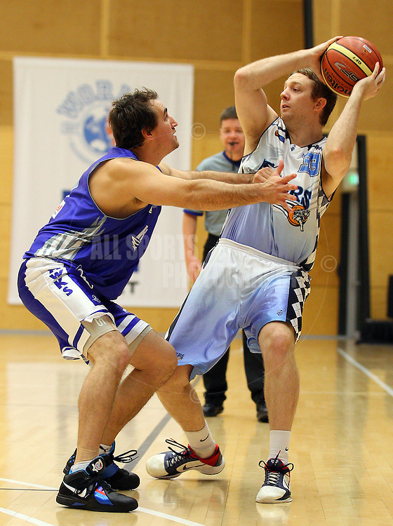 PERTH, AUSTRALIA - JULY 16: Sam Keene of the Hawks holds out Adam Nener of the Tigers during the week 18 SBL game between the Perry Lakes Hawks and the Willetton TIgers at The State Basketball Center on July 16, 2011 in Perth, Australia.  (Photo by Paul Kane/Allsports Photography)