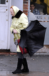 © Licensed to London News Pictures. 03/01/2012. London, UK. An elderly woman battles heavy rain and winds on Pettswood High Street, London on January 3rd, 2012. The Met Office has issued a severe weather warning as heavy rain and 85mph winds battered Britain. Photo credit : Grant Falvey/LNP